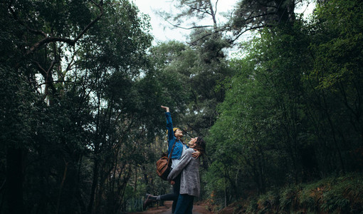 Beautiful rainforest with couple enjoying