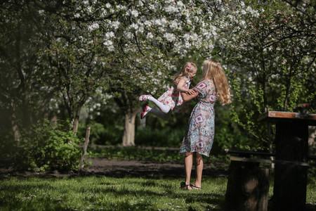mother twist daughter in the garden