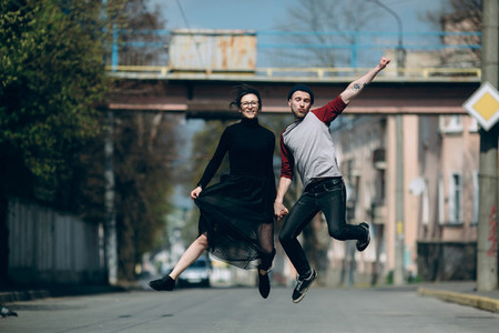 Beautiful young couple jumping