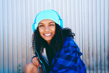 Young beautiful woman listening to music
