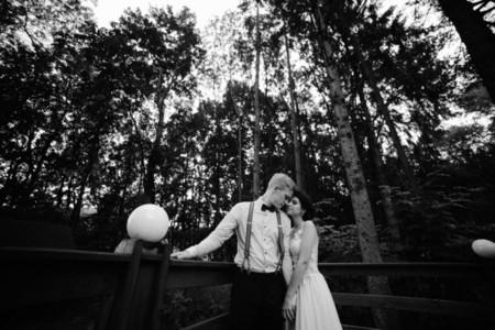bride and groom posing on the verandah