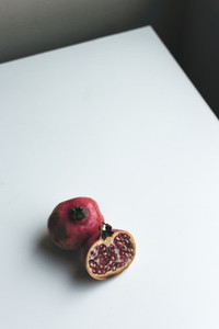 Fresh cut pomegranate on a white