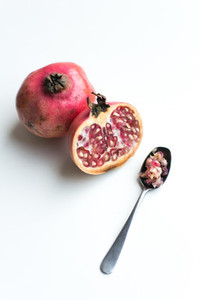 Fresh cut pomegranate on a white