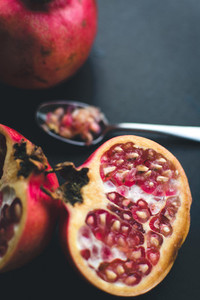 Fresh cut pomegranate on a woode
