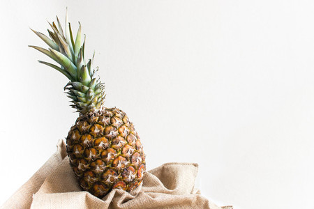 Fresh funky pineapple with a whi