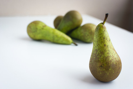 Fresh organic pears on a white background