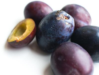 Fresh organic plums detail