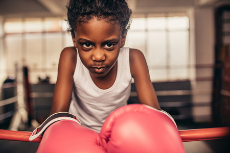 Close up of a boxing kid wearing boxing gloves