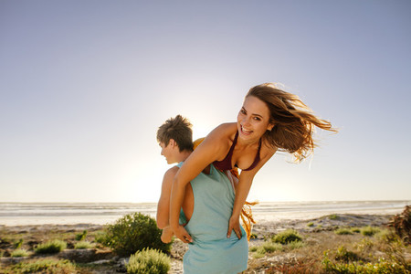 Couple on vacation in romantic mood at the beach
