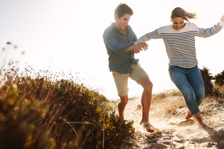 Couple enjoying and having fun on the beach