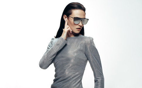 Woman in sliver outfit and mirrored glasses