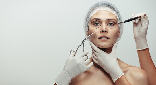 Woman under going a face lift surgery