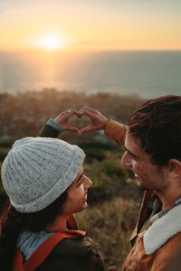 Couple deeply in love standing on mountain