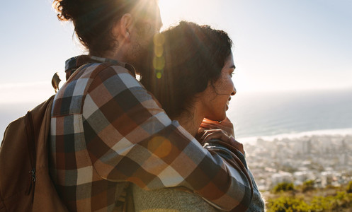 Affectionate young couple admiring the view