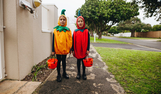 Twin sisters trick or treating on Halloween