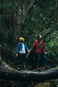 Couple hiking in forest on a rainy day