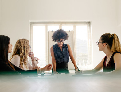 Group of women having a meeting in boardroom