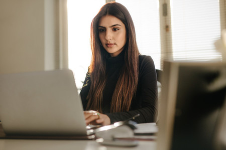 Beautiful young woman working at her desk