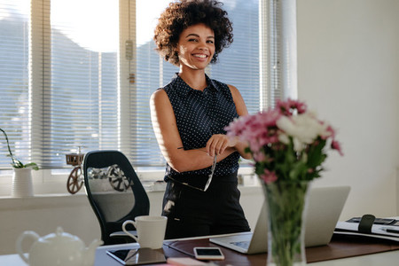Confident african businesswoman at her workplace