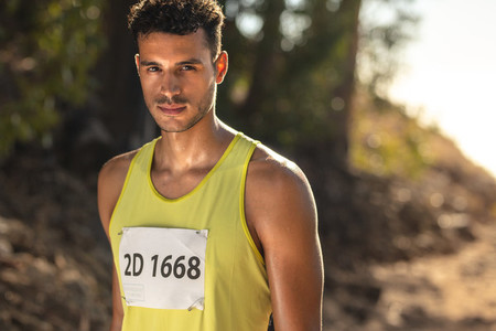 Man competing in mountain trail race
