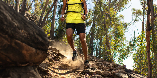 Trail runner on challenging rocky terrain