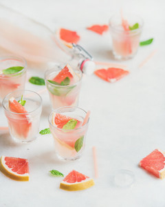 Cold refreshing alcohol cocktail with fresh grapefruit  white background