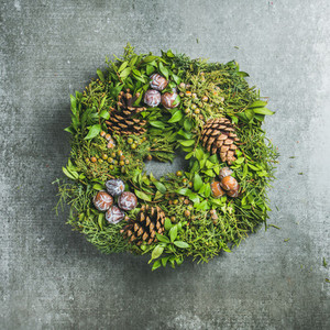 Christmas decorative wreath over grey concrete wall background square crop