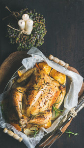 Christmas dinner with roasted chicken  rosemary and decorative candles