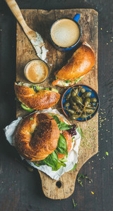 Breakfast with bagel  espresso coffee and capers in blue bowl