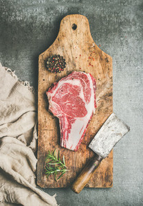 Meat dinner concept with raw beef steak rib eye with seasoning
