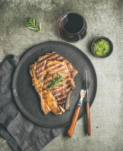 Flat lay of Grilled hot rib eye beef steak on bone