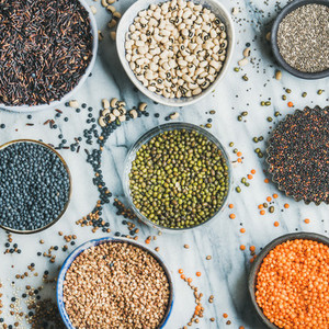 Various raw uncooked grains  beans  cereals  marble background  square crop