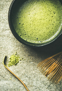 Flat lay of freshly brewed Japanese matcha tea in Chasen bowl