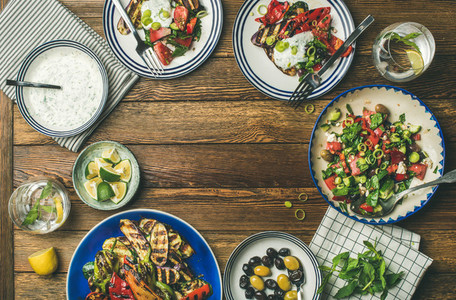 Flat lay of healthy vegetarian dinner table setting