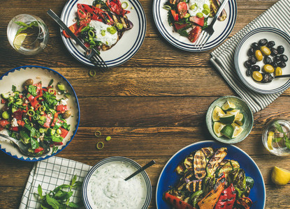 Flat lay of healthy dinner table setting with vegetarian appetizers