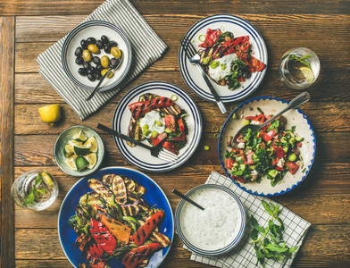Flat lay of healthy dinner table setting with snacks   top view