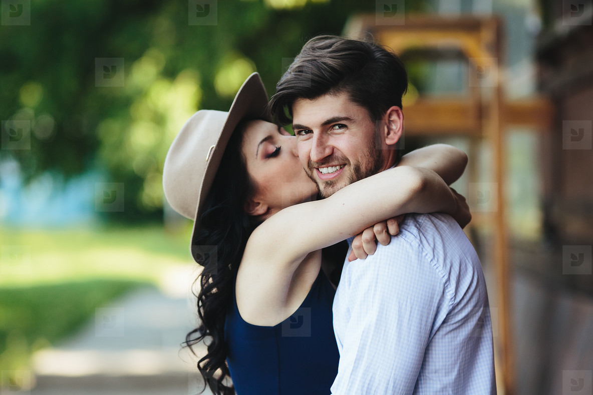 beautiful girl embraces and kisses her boyfriend
