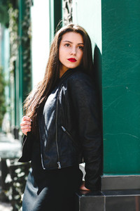 Glamorous young woman in black leather jacket
