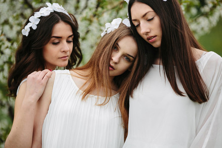 Three charming girls  in a garden