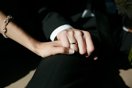 Wedding ring on hand with a sun shine