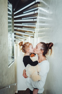 Mom and little daughter in their arms