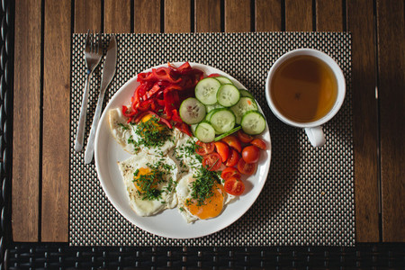 Fried eggs with vegetables  tea