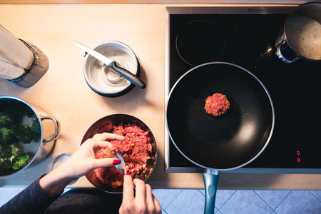 Frying meatballs on pan