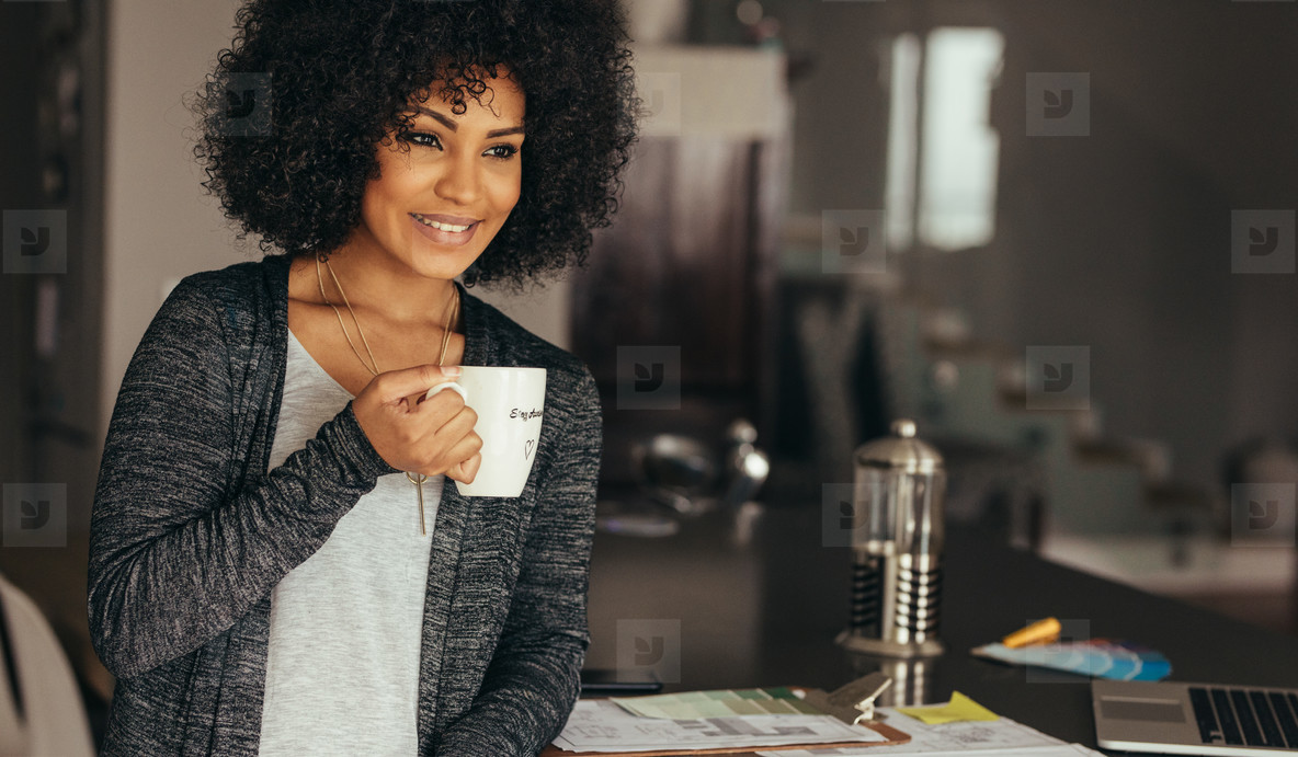 Smiling woman taking coffee break