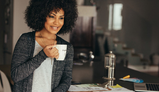 Smiling woman taking coffee break