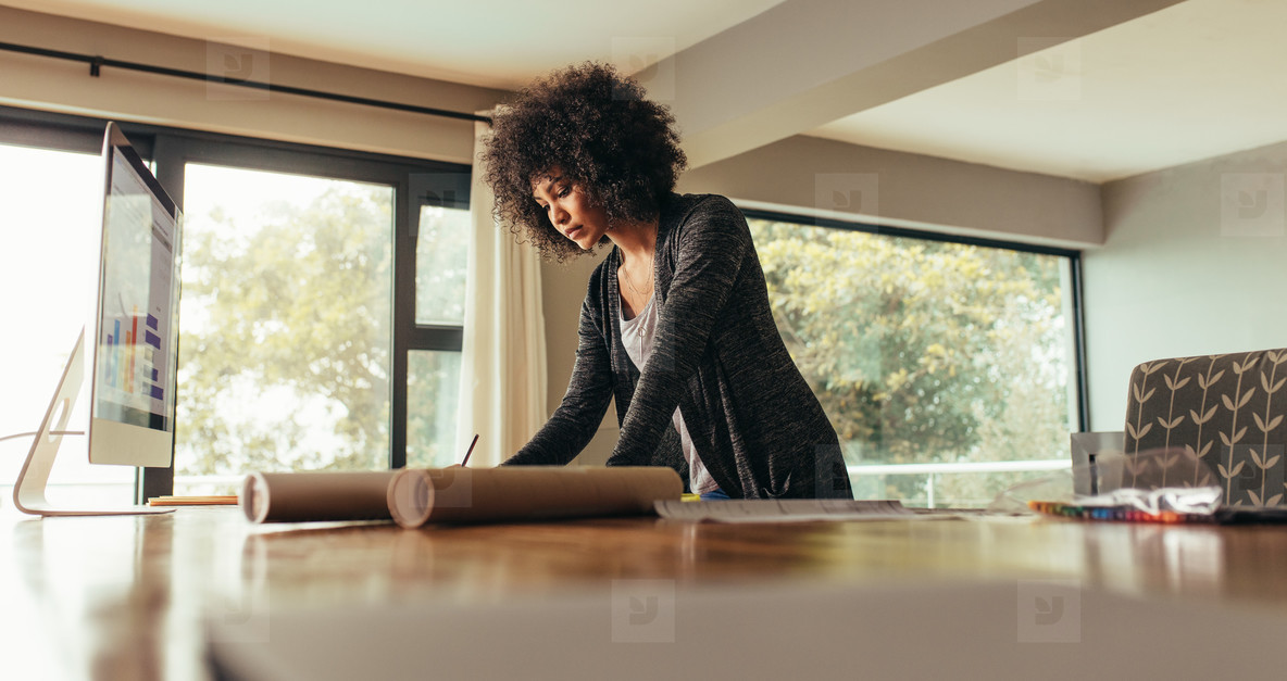 Female architect working at home office