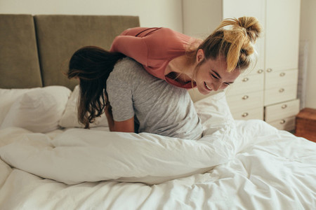Couple having fun on bed at home
