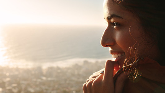 Smiling woman looking at beautiful view