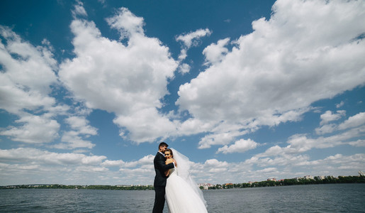 couple on blue sky background water