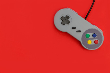 Retro video game controller red background